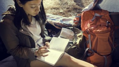 Woman Reading Traveling Destination Camping Concept